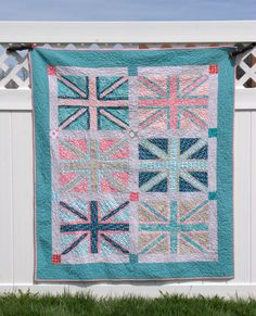 Victory Gardens quilt from a Busy Bee Quilt Designs pattern. H's mini-me version of Adam's Union Jack.