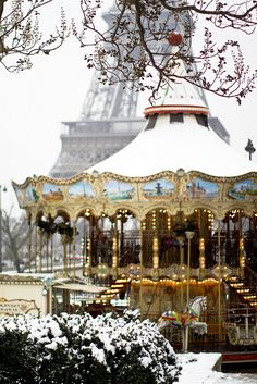 carousel in the snow at the Eiffel Tower by Making Magique
