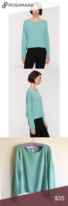 """Eileen Fisher Calypso Bateau Neck Sweater Size SM Gorgeous Eileen Fisher Calypso Bateau Neck Sweater w/ Rolled Edges. Size Small. Super soft! Beautiful color! Greeny blue--a deep aqua color. Dropped shoulders, seam-out detail, rolled edges at cuffs and hem. Excellent Condition. 100% Organic Cotton. Machine Wash. Tumble Dry Low. W: 24"""" L: 19.5"""" Eileen Fisher Sweaters Crew & Scoop Necks"""