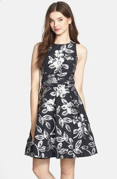 This floral silver and black dress makes for the perfect engagement party holiday dress! Find out more great styles (and where to buy this dress) in the post!