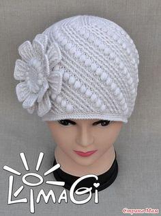 """Эту шапку начинала вязать до """"Машеньки"""", но размер из-за ширины раппорта не выходил нужным, да и потом решили сделать шапку поярче, и ушки сюда не очень просились..."""