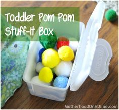 toddler busy bag pom pom - I am so going to do this for A using our old tiny baby socks.