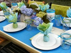 Blue runners on each side. Placed on top of a white table cover. - tabletop