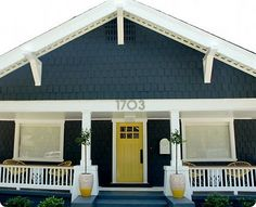 I really want this dark gray/ blue paint and bright white accents for our house. That yellow door is awesome too! Maybe for a side door?