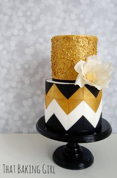 Black white and gold cake with edible sequins, tiles and wafer paper flower
