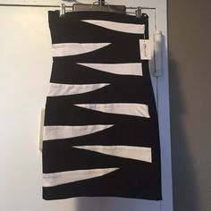"""NWT Bodycon dress Black and white striped dress, never before worn. Measures 24.5"""" from top to bottom. Tube top, straight across top. Perfect for night out when you want to feel sexy! Pair with stilettos for glam look or Adidas shells and leather jacket for daytime look. mandee Dresses"""