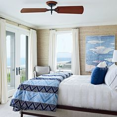 A seafront bedroom with ocean-inspired hues and soothing water views