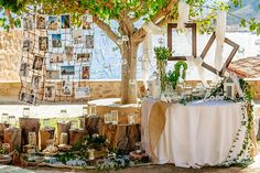 For the wonderful decor Ioanna Vamvakari used vases with fresh flowers, burlap sacks with ivy, candles decorated with lace, burlap and twine, white lanterns and koufeta. #burlap #ceremonydecorideas See more http://www.love4weddings.gr/unique-wedding-decoration-ideas/
