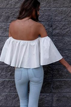 Its the chic way of life! Crop tops are back baby! It features off shoulder and ruffle design. Pair with denim pants and stiletto heel sandals for a chic look.
