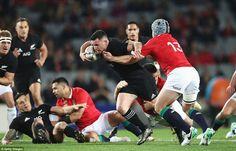 Ryan Crotty tries to evade the challenge of Jonathan Davies and set New Zealand on their w. British And Irish Lions, New Zealand, Challenges, Tours