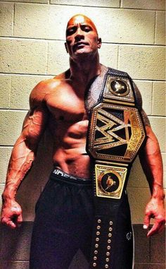 """The Rock  - WWE Champ and owner/operator of the """"Smackdown Hotel."""""""