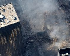 """WTC 9/11 share and attribute user slagheap, via Flickr. New York, New York (Sep. 19, 2001) -- """"Ground Zero"""" at the World Trade Center disaster. Released U.S. Navy photo by Photographer's Mate 2nd Class Aaron Peterson."""