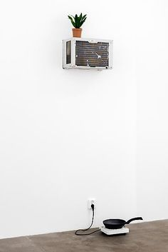 Mika Rottenberg, Tsss 2013 Air conditioner, plant, hotplate, frying pan, water Dimensions variable