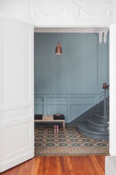 Denim Drift on pannelled wall in an updated classical hallway looks amazing with the pretty pattern on the floor tiles Image: Pinterest