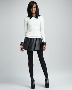 Black button down shirt, white sweater, black leather skater skirt, tights, black booties. Shop
