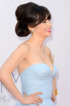 Deschanel's ample updo is extremely flattering due to the volume at both the crown and in the back. It looks beautiful in pictures from all angles.
