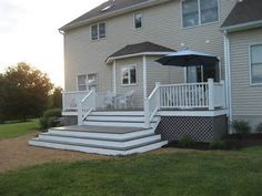 Custom Deck Design to open up the view by Kosh Construction