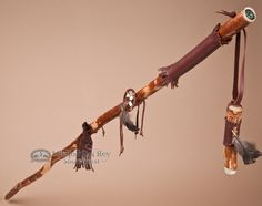 This isa beautiful handcrafted Tigua Indian medicine staff walking stick made with real sassafras wood and a matching wooden whistle. Adorned with real hand stitched leather, a medicine wheel with the