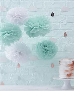 Cute mint green and white pom poms that would be perfect baby shower decorations. Discover our whole range of Hello World baby shower supplies at partydelights.co.uk.