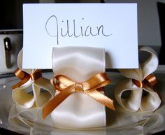 Ribbon place cards.  http://www.weddingthingz.com/1/post/2012/08/ribbons-for-your-wedding.html