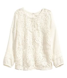 Can't have too many white lace blouses