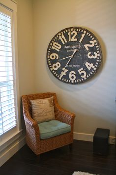 Need to fill up wall space? Add a over-sized clock or piece of decor to make an effortless style update.