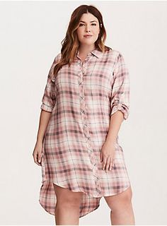 """<div>Look like a grunge goddess straight outta the 90's. Blush pink, white, and grey plaid is splashed over breathable and breezy rayon, the longer hi-lo hem adding some lift to the flowy fit. Button down front and 3/4 tab sleeves polish off the look.</div><div><br></div><div><b>Model is 5'9"""", size 1</b></div><div><ul><li style=""""list-style-position: inside !important; list-style-type: disc !important"""">Size 1 measures 41 1/2"""" from shoulder</li><li style=""""list-style-position: insid..."""