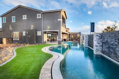 Take a swim and enjoy the outdoors with this striking backyard space from Toll Brothers at Inspirada, Laramie model in Henderson, NV. Toll Brothers, Henderson Nv, Outdoor Living Areas, Real Estate Houses, House Exteriors, New Homes For Sale, Summer Parties, During The Summer, View Photos