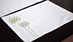 Queen Ann placemat which made from cream linen and embroidered with green flower. The placemat measure 14 x 18 made from 2 layer linen fabric which inserting with interfacing fabric. This listing is for set of 4 placemats. Please convo me if you need custom item with this design. Coordinating table runner is available here https://www.etsy.com/listing/207265747/table-runner-linen-table-runner-cream?ref=shop_home_active_20 More placemats and table runners are av...