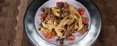 Michael Symon's Creamy Fettuccine with Spicy Sausage & Cherry Tomatoes