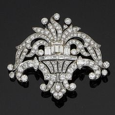 An art deco diamond giardinetto brooch, circa 1925  Set throughout with old brilliant, single, baguette and marquise-cut diamonds, with a step-cut diamond to the centre, all within millegrain settings, diamonds approximately 7.00 carats