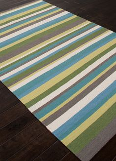 Bold Stripes Of Turquoise And Green Shades Make Up This Capri Inspired Wool Flat Weave Area Rug Perfect For A Calming Relaxing Complement To Any Coastal