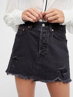 Deconstructed Denim Skirt | Denim mini skirt featuring allover distressed detailing. * Raw hem * Five-pocket style * Button fly