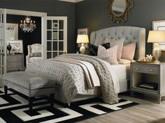 So many great design details in this serene gray bedroom.  Mixing shades of gray and  loads of texture.   Black and white adds a graphic touch
