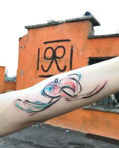 Watercolor Paradox Tattoo