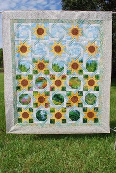 While I'm not a big sunflower fan, this quilt just makes me smile ... and it's beautiful to boot!