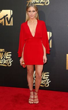 Brittany Snow from MTV Movie Awards 2016 Red Carpet Arrivals  Talk about looking Pitch Perfect! The actress looks like a true star in her red V-neck cape dress from Haney.