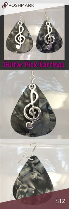 """Grey Pearlescent Guitar Pick Treble Clef Earrings These music-themed earrings are made with genuine charcoal grey celluloid guitar picks, Tibetan antique silver treble clef charms, & silver-plated ear wires & rings. 2"""" including ear wire*. Handcrafted by me.   *Can be replaced with Sterling Silver for an additional $1. Comment for a listing.  Jewelry items are priced firm as a single purchase due to material cost & PM fees.   Bundle special on guitar pick jewelry ONLY: Any 2 items for $20…"""