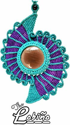 Micro Macrame pendant with large bead.  Love the colors.