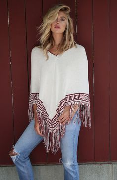 Designed with a lighter knit, V-shaped cut, and visible seam down the middle. Features include fringe and a detailed print lining the bottom of the garment. - Modeled in size s/m - Made in Brazil - 50