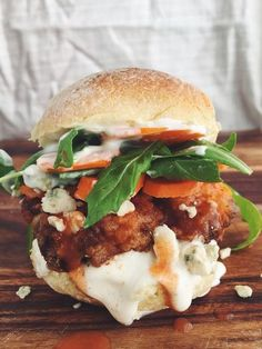 Fried Chicken Po'boy Sandwich with buttermilk fried chicken, lettuce, tomato, mayo, and pickles on french bread