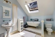 Bathrooms can gain a lot of space and light by the addition of a velux window