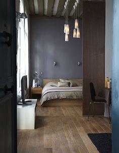 Wood Floors and dark grey walls.