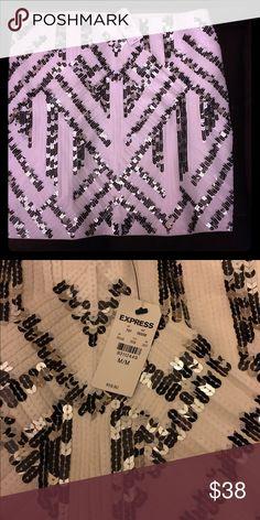Express mini skirt (M) Brand new Express mini skirt, stretch. White with silver and black. Express Skirts Mini