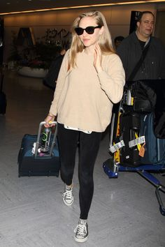 Amanda Seyfried looked laidback in leggings, a slouchy jumper and Converse as she came through Narita International Airport in Japan with boyfriend Justin Long.