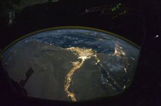 A night time photograph made by an International Space Station Expedition 25 crewmember shows the bright lights of Cairo and Alexandria, Egypt on the Mediterranean coast as well as the Nile River and its delta which stand out clearly in this image released by NASA and taken October 28, 2010. REUTERS/NASA
