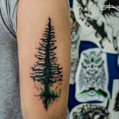 Pine tree tattoo. Had to pin because that use of green is amazing! I don't usually like colored tattoos but this is so tasteful, and my favorite color!