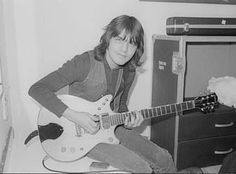 Malcolm Young tuning his guitar backstage in Rock And Roll Bands, Rock N Roll, Malcolm Young, Ac Dc Rock, Bon Scott, Types Of Guitar, I Love Him, Cool Bands, My Boys