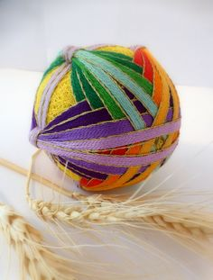 Japanese Temari - colored silk thread is arranged to the artists' whim.  Beautiful!