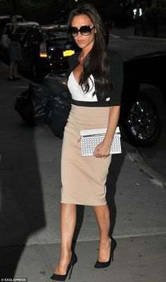 Chic and sophisticated: Victoria Beckham was well and truly back to her effortlessly chic best as she stepped out in New York City on Tuesday in a form-fitting midi-dress
